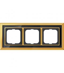 Рамка ABB Dynasty трехместная (латунь полированная, черное стекло)
